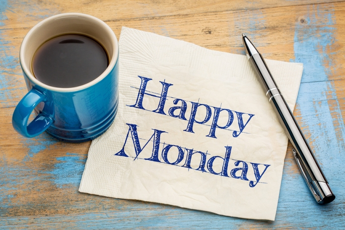 Happy Monday -  cheerful handwriting on a napkin with a cup of c